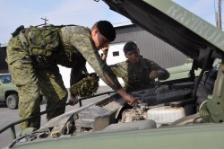 Sgt Kerluke and Cpl Keller Conduct Vehicle Maintenance Checks on the LUVW (G-Wagon's). Picture by Cpl Desmarais