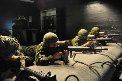 BCD Members Complete Personal Weapons Test 1 & 2 (PWT 1 & PWT 2) on the Small Arms Training System (SAT) virtual training system. Picture by Cpl Desmarais