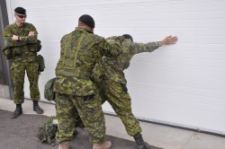 Sgt. Barber Instructs on the Propper Procedures for Personnel and Vehicles Searches. Picture by Cpl Desmarais